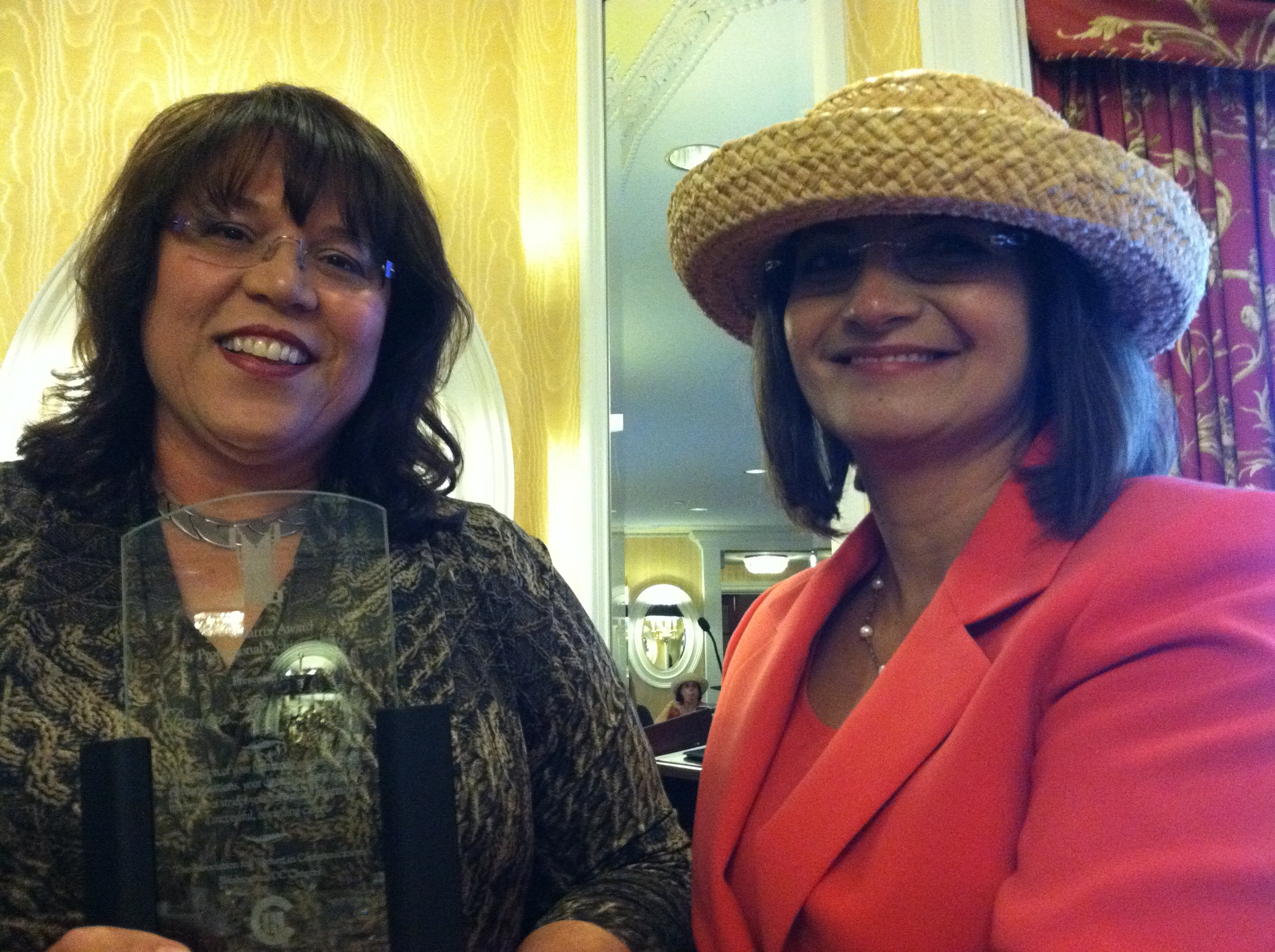 Donna Vincent Roa receives the 2011 Matrix Award from AWC-DC co-president Bina Handa
