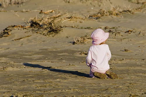 young toddler playing in the sand