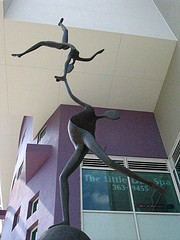 Sculpture of acrobats lifting balancing each other.