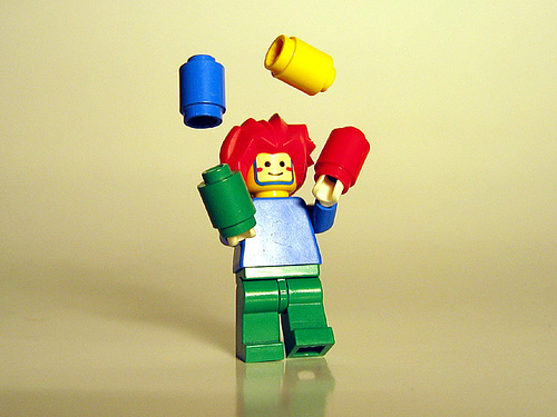 He juggles legos like a business owner juggles tasks.