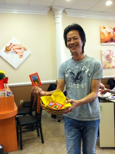 Pham holding lucky red envelopes for Chinese New Year 2013
