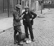 British Intelligence sergeant questioning a stranger