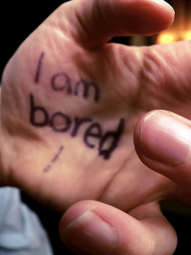 "hand with ""I am bored"" written on it"