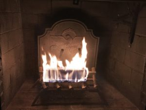 warming fire in fireplace