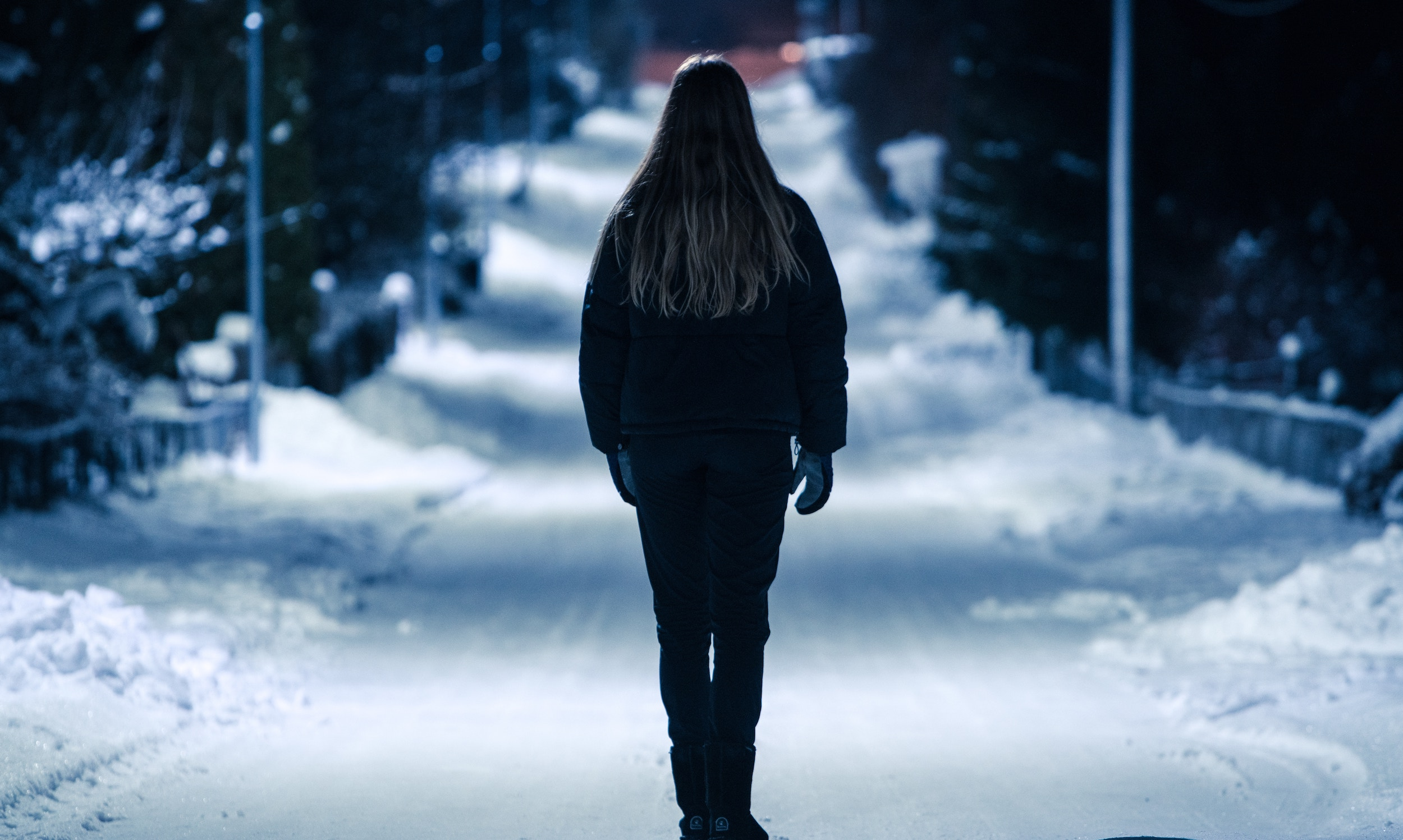 girl looking out at snow